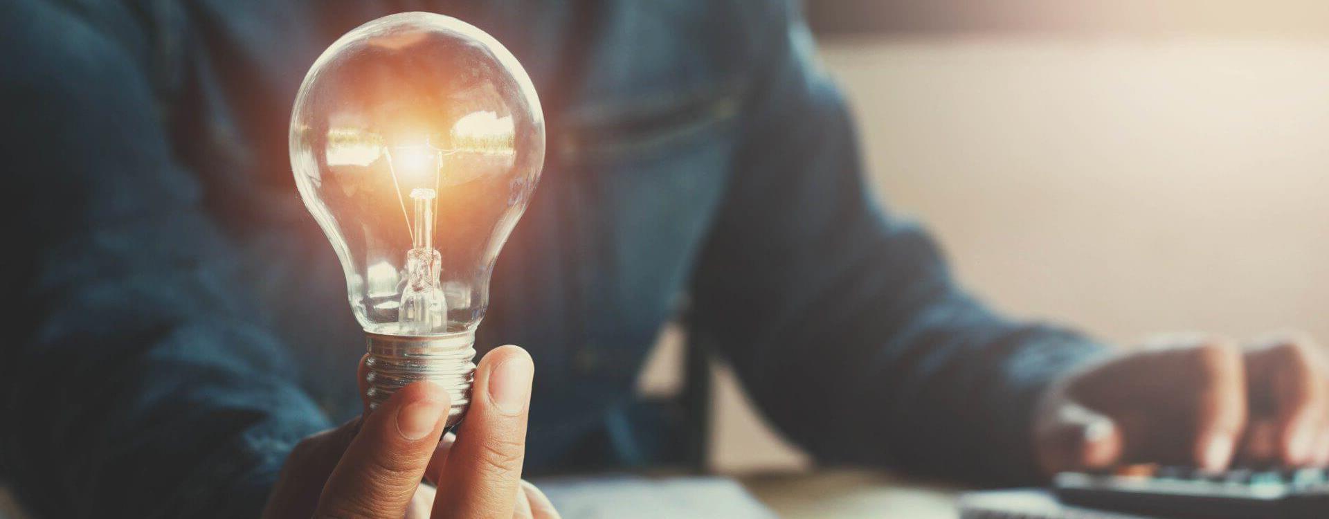 holding light bulb